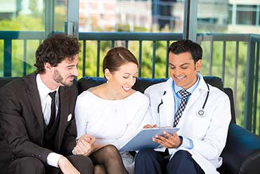Doctor with Clients sitting on couch
